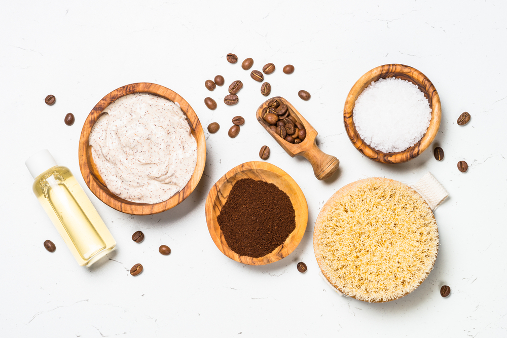 Natural Coffee cosmetic on white background. Ingredient for makihg homemade cosmetics. Spa, body care concept. Flat lay image with copy space.